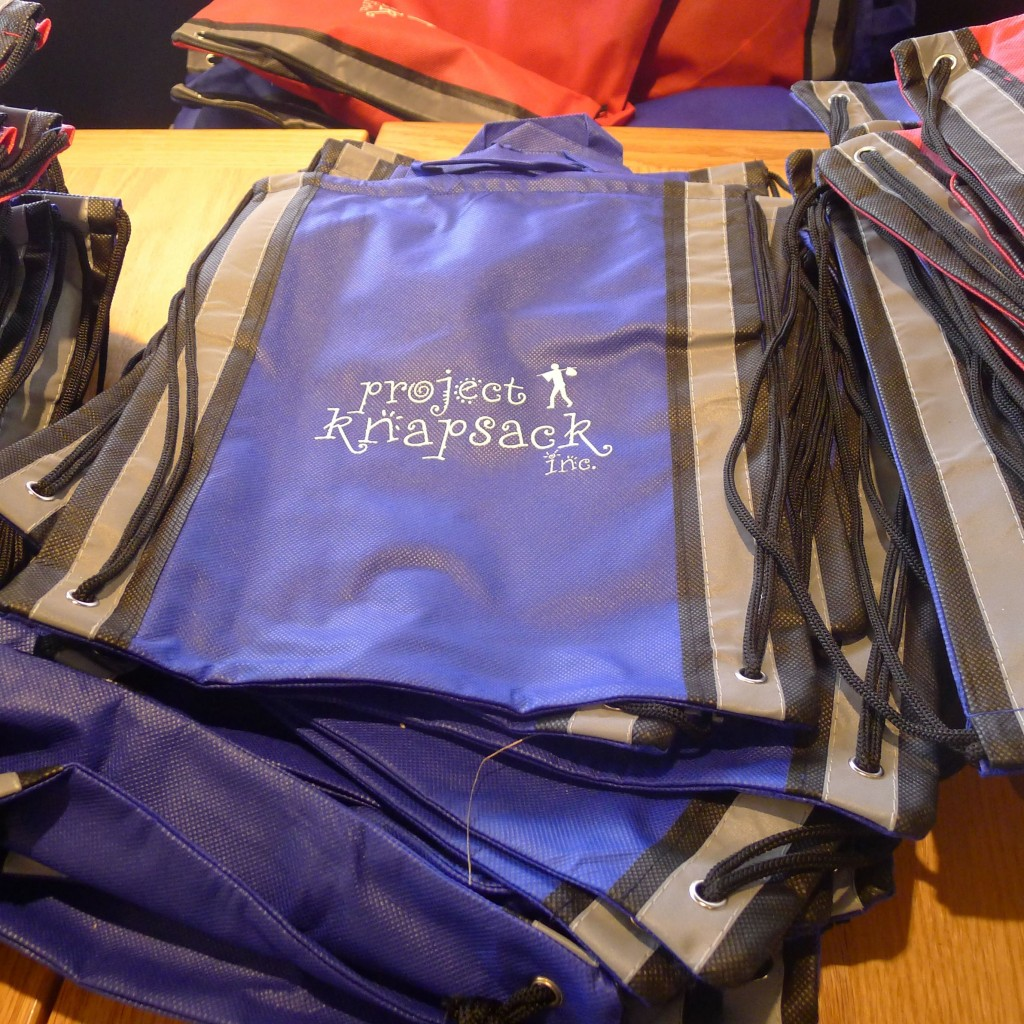 The knapsacks filled with pencils, dictionaries, composition books and more!