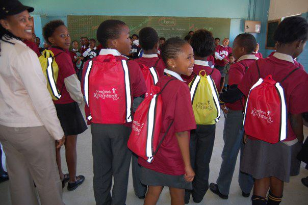 Porcha Dodson, Beyond The Brochure co-author, with school kids in Soweto, S. Africa. Porcha's non-profit, Project Knapsack, delivered backpacks filled with school supplies to the kids.