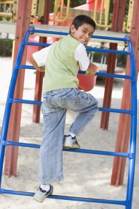 Boy on climbing frame