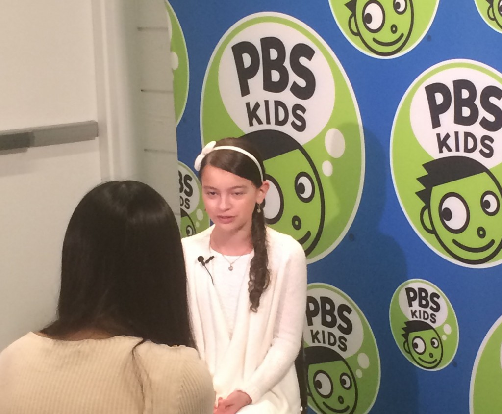 Agent Olive being interviewed at the screening of Odd Squad